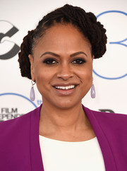 Ava DuVernay attended the Film Independent Spirit Awards rocking her signature dreadlocks in an upswept style.