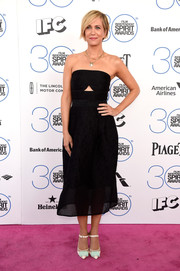 Kristen Wiig stayed on trend in a Yigal Azrouel strapless LBD with a midriff cutout during the Film Independent Spirit Awards.