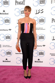 Carmen Ejogo looked very trendy on the Film Independent Spirit Awards pink carpet in a Roksanda strapless jumpsuit with colorful accents on the bodice.