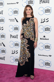 Stana Katic graced the Film Independent Spirit Awards pink carpet wearing a Chloe gown embellished with striking patches of metallic accents.