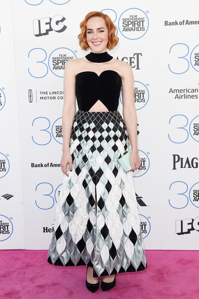 Jena Malone added a subtle flash of color with a pale-mint box clutch.