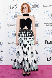 Jena Malone looked electrifying at the Film Independent Spirit Awards in a very artful Ulyana Sergeenko creation, featuring a monochrome, quilted skirt and peekaboo detailing on the bodice.