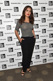 Salma Hayek was casual yet stylish (and very curvy) in this fitted black-and-white striped top during the Film Society of Lincoln Center Summer Talks.