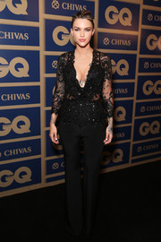 Ruby Rose donned an alluring look in this sheer, lace black jumpsuit with a plunging V-neck and beaded details