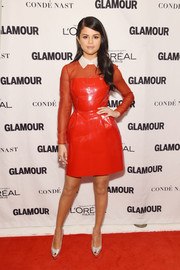 Selena Gomez made a unique statement in a red Valentino polyvinyl and organza dress during the Glamour Women of the Year Awards.