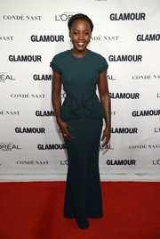 Lupita Nyong'o cut a shapely silhouette in a figure-hugging teal peplum gown by Jason Wu at the Glamour Women of the Year Awards.