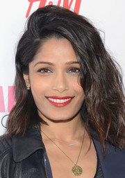 Freida Pinto's red lipstick looked striking against her luminous skin.
