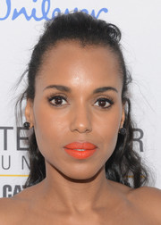 Kerry Washington brightened up her pout with orange lipstick.