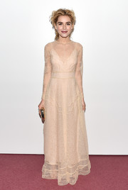 Kiernan Shipka had a romantic look in this soft cream lace dress with sheer paneling and long-sleeves.