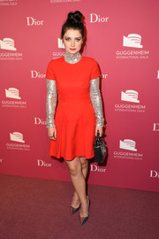 Eve Hewson polished off her look with silver Dior pumps.