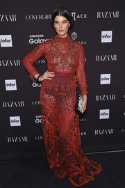 Crystal Renn looked sultry in a sheer, embroidered red gown at the 2015 Harper's Bazaar Icons event.