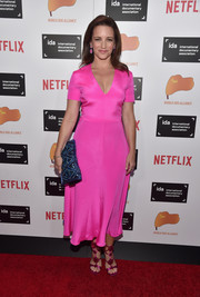 Kristin Davis matched her dress with a pair of strappy magenta evening sandals.
