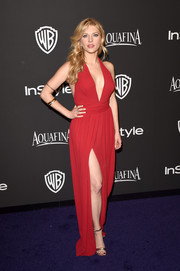 Katheryn Winnick oozed major sex appeal at the InStyle and Warner Bros. Golden Globes party in a red halter gown that showcased both cleavage and legs.