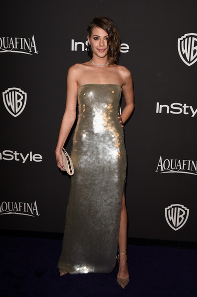 Willa Holland went for high shine in a sequined gold strapless dress at the InStyle and Warner Bros. Golden Globes party.