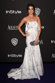 Nikki Reed looked ethereal at the InStyle and Warner Bros. Golden Globes party in a floor-sweeping Katharine Kidd strapless dress in white with swirls of gray.
