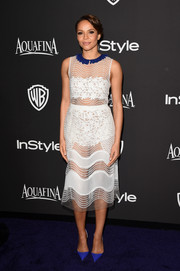 Carmen Ejogo put plenty of skin on display in a mixed-pattern sheer white dress by Self Portrait at the InStyle and Warner Bros. Golden Globes party.