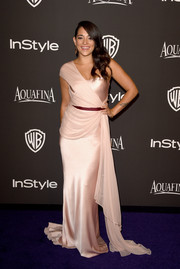 Natalie Martinez channeled her inner goddess in a draped pink one-shoulder gown at the InStyle and Warner Bros. Golden Globes party.