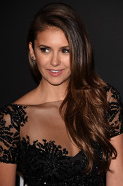 Nina Dobrev looked darling at the InStyle and Warner Bros. Golden Globes party wearing this feathery side sweep.
