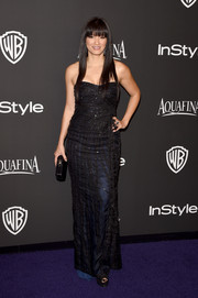 Kelly Hu opted for an embroidered black strapless gown with a blue underlay for her InStyle and Warner Bros. Golden Globes party look.
