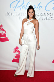 Paulina Vega opted for a white crossover-neckline jumpsuit when she attended the Latin Grammy Person of the Year event.