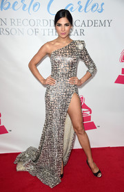 Alejandra Espinoza flaunted major leg in a metallic one-shoulder gown with a hip-grazing slit during the Latin Grammy Person of the Year event.