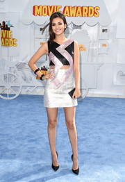 Victoria Justice went for disco glamour in a tricolor beaded mini dress by Versace during the MTV Movie Awards.