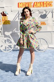 Charli XCX sported a fun blend of colors with this plaid plastic raincoat by Jeremy Scott at the MTV Movie Awards.