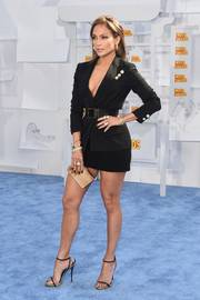 Jennifer Lopez kept the allure going with a pair of black and gold slim-strap heels by Giuseppe Zanotti.