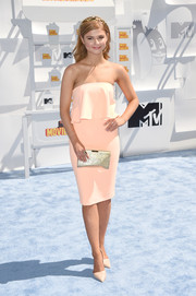 Stefanie Scott added glamorous shine via a metallic gold clutch by Milly.