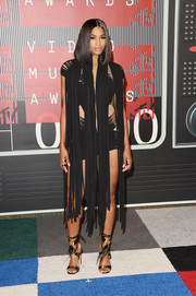 Ciara's feathered black and gold ankle-tie sandals coordinated perfectly with her dress.