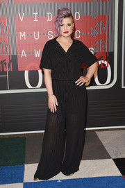 Kelly Osbourne kept it low-key at the MTV VMAs in a double-breasted pinstripe jumpsuit.