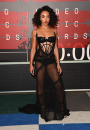 FKA Twigs was boudoir-glam in a sheer black corset gown by Atelier Versace at the MTV VMAs.