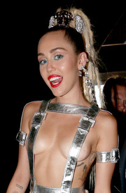 Miley Cyrus sports a Roman numeral tattoo on her right arm.