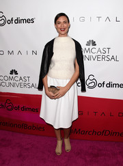 Odette Annable teamed her top with a simple white knee-length skirt.