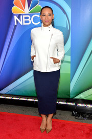 Melanie Brown chose a blue knit pencil skirt to team with her jacket.