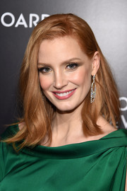 Jessica Chastain styled her red locks into a simple straight 'do with just a bit of a flip down the ends for the National Board of Review Gala.