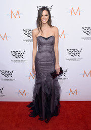 Allie Rizzo looked alluring in a strapless gray corset gown with a ruffled skirt during the 2015 to the Rescue! New York Gala.