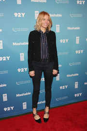 Sienna Miller contrasted her chic jacket with casual skinny jeans.