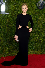 Taylor Schilling was modern and edgy at the Tony Awards in a long-sleeve black Michael Kors gown with an exposed midsection.