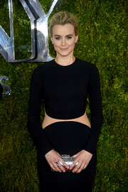 Taylor Schilling paired a metallic silver clutch with a black cutout dress, both by Michael Kors, for a modern-glam look during the Tony Awards.