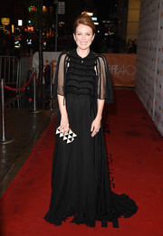 Julianne Moore went goth in a voluminous black Valentino Couture gown during the TIFF premiere of 'Maggie's Plan.'
