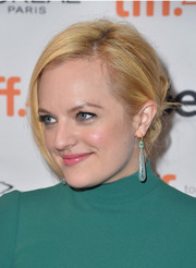 Elisabeth Moss attended the TIFF premiere of 'Truth' wearing her hair in a twisted bun.