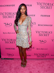 Jasmine Tookes went all out with the shimmer pairing her sparkly dress with silver strappy sandals.