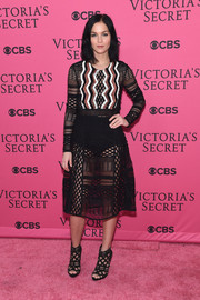 Leigh Lezark put on a sultry display at the Victoria's Secret fashion show in a sheer mixed-pattern dress with an embellished bodice.