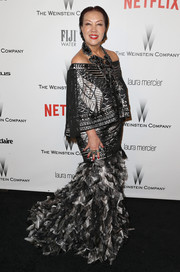 Sue Wong chose a frothy black and silver off-the-shoulder gown for the Weinstein Company and Netflix Golden Globes party.