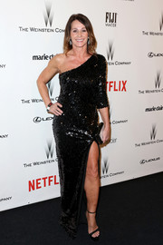 Nadia Comaneci went for some sexy shine in a fully sequined one-shoulder gown with a thigh-baring slit during the Weinstein Company and Netflix Golden Globes party.