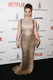 Alyssa Milano was all a-glitter in a beaded gold gown at the Weinstein Company and Netflix Golden Globes party.
