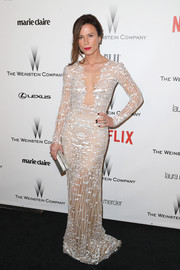 Rhona Mitra oozed glamour and sex appeal in a sheer, embroidered evening dress at the Weinstein Company and Netflix Golden Globes party.