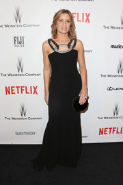 Kim Dickens donned a black gown with chain-like shoulder straps for the Weinstein Company and Netflix Golden Globes party.