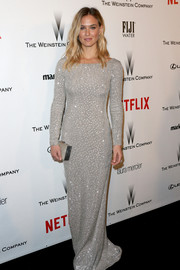Bar Refaeli sheathed her supermodel figure in a sparkly silver column dress for the Weinstein Company and Netflix Golden Globes party.